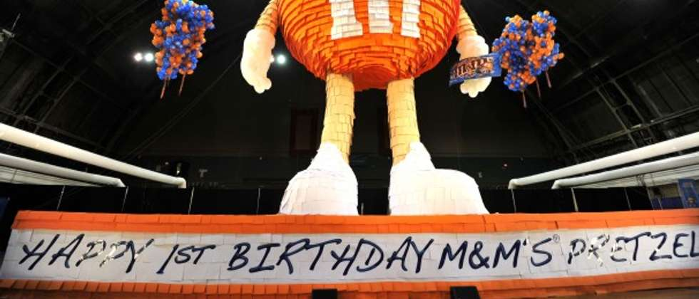 A 46 foot piñata in the form of an orange M&M candy, filled with thousands. Aug. 4, 2011 ( Sam Yeh/AFP )