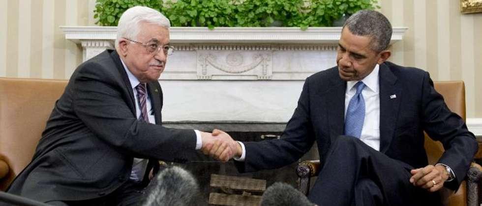 Le président de l'Autorité palestinienne Mahmoud Abbas (g) et Barack Obama à la Maison Blanche, le 17 mars 2014 ( Saul Loeb (AFP) )