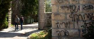 People leave the Deir Rafat Catholic convent whose walls were sprayed with a graffiti near the Israeli city of Beit Shemesh, west of Jerusalem on April 1, 2014 ( AFP Photo/Menahem Kahana )