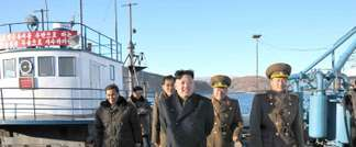 This undated picture released from North Korea's official Korean Central News Agency (KCNA) on December 16, 2013 shows North Korean leader Kim Jong-Un (C) visiting the August 25 Fisheries Station under Korean Peoples' Army (KPA) 313 Unit ( KCNA via KNS/AFP/File )