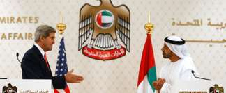 John Kerry (left) reaches out to shake hands with UAE Foreign Minister Abdullah bin Zayed Al Nahyan at the foreign ministry in Abu Dhabi, on November 11, 2013 ( Jason Reed (Pool/AFP) )
