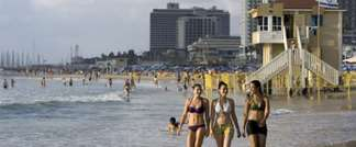 Israeli women stroll along the beach in Tel Aviv. ( Jonathan Nackstrand/AFP )