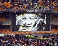 A screen shows South African former president Nelson Mandela during his memorial service at the FNB Stadium (Soccer City) in Johannesburg on December 10, 2013 ( Odd Andersen (AFP) )
