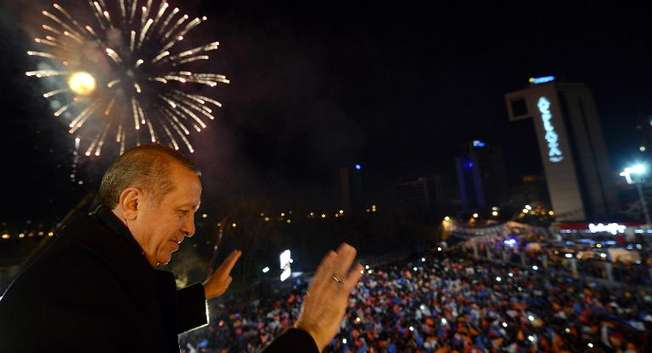 Turkish Prime Minister Tayyip Erdogan greets his supporters in Ankara, on March 30, 2014 ( Kayhan Ozer (Prime Minister Press Office/AFP) )