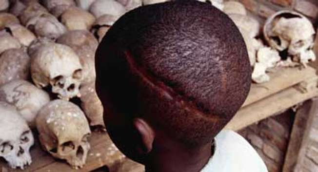A Rwandan child stares at the skulls of some who were massacred in and around the Nyamata Catholic Church and the surrounding Kanzenze community in 1994. Nearly one million Rwandans were murdered (  )