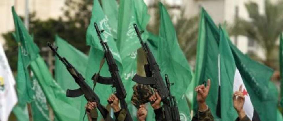 Palestinian supporters of Hamas wave their guns and green flags of Hamas during a rally in Gaza City on December 8, 2012 (AFP)