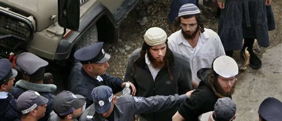 A police raid on Yitzhar's yeshivot following an arson attack on a West Bank mosqu, 2010