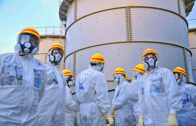 International Atomic Energy Agency handout photo taken on November 27, 2013 shows review mission members inspecting the crippled Fukushima nuclear power plant in Okuma, Fukushima prefecture (IAEA (IAEA/AFP/File))