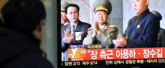 A South Korean man watches TV news about the alleged dismissal of Jang Song-Thaek, North Korean leader Kim Jong-Un's uncle, at a railway station in Seoul on December 3, 2013 (Jung Yeon-Je (AFP/File))