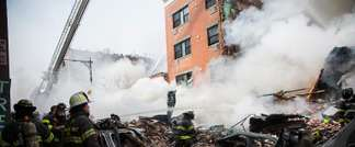 Firefighters from the Fire Department of New York (FDNY) respond to a 5-alarm fire and building collapse at 1646 Park Ave in the Harlem neighborhood of Manhattan on March 12, 2014 in New York City (Andrew Burton (Getty/AFP))