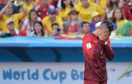 Cristiano Ronaldo reacts after Portugal were booted out of the World Cup despite winning against Ghana at the Mane Garrincha National Stadium in Brasilia on June 26, 2014 ( Gabriel Bouys (AFP) )